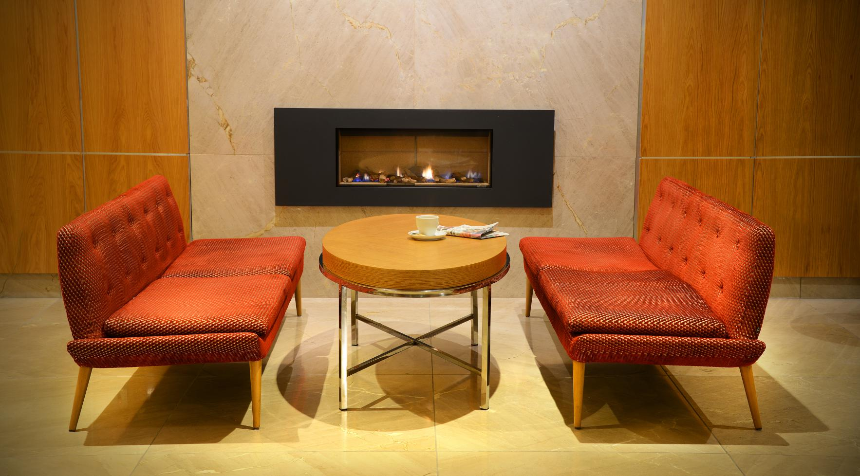 3.1 sofa in front of fireplace in Clayton Hotel Burlington Road lobby lounge