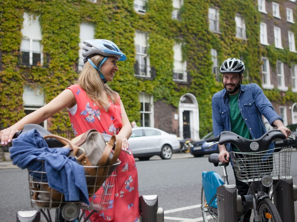 Couple biking around St Stephen Green Dublin
